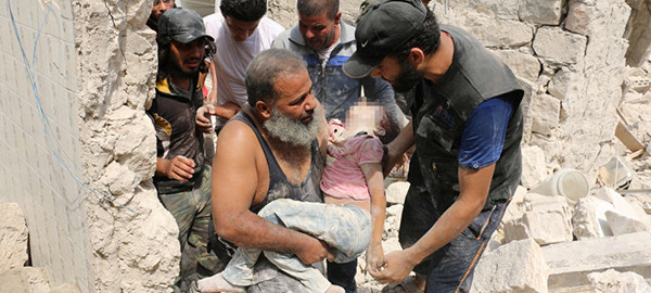 PIXELLATED VERSIONS  EDITORS NOTE: Graphic content / A wounded Syrian man sits in the back of a truck next to a dead girl following a barrel bomb attack on the Bab al-Nairab neighbourhood of the northern Syrian city of Aleppo on August 25, 2016. / AFP PHOTO / AMEER ALHALBIAMEER ALHALBI/AFP/Getty